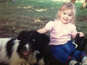 My daughter at a young age along with our dog, Preacher.