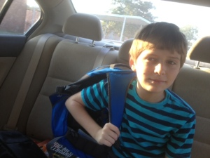 Dropping off my son at school, as he gets set to head to the playground for some early recess time.