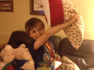 My son, always dangerous when armed with a pillow.