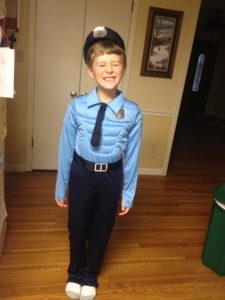 Last year, my son (who wouldn't be serious long enough for me to take a picture) wanted to dress up as a policeman. This year, sadly, he won't be dressing up at all.