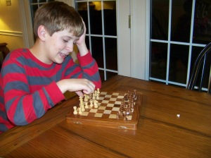 My son challenged his lost tooth to a game of chess. Fortuntely, my son was able to pull out the win.