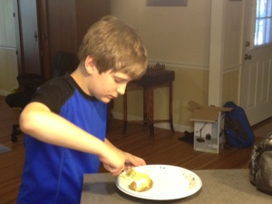 My son prepares to take a giant step in his life - trying a baked potato for the first time.