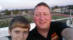 My son and I have found new ways to spend time together. Here we are on top of a press box before I broadcast a high school football game.